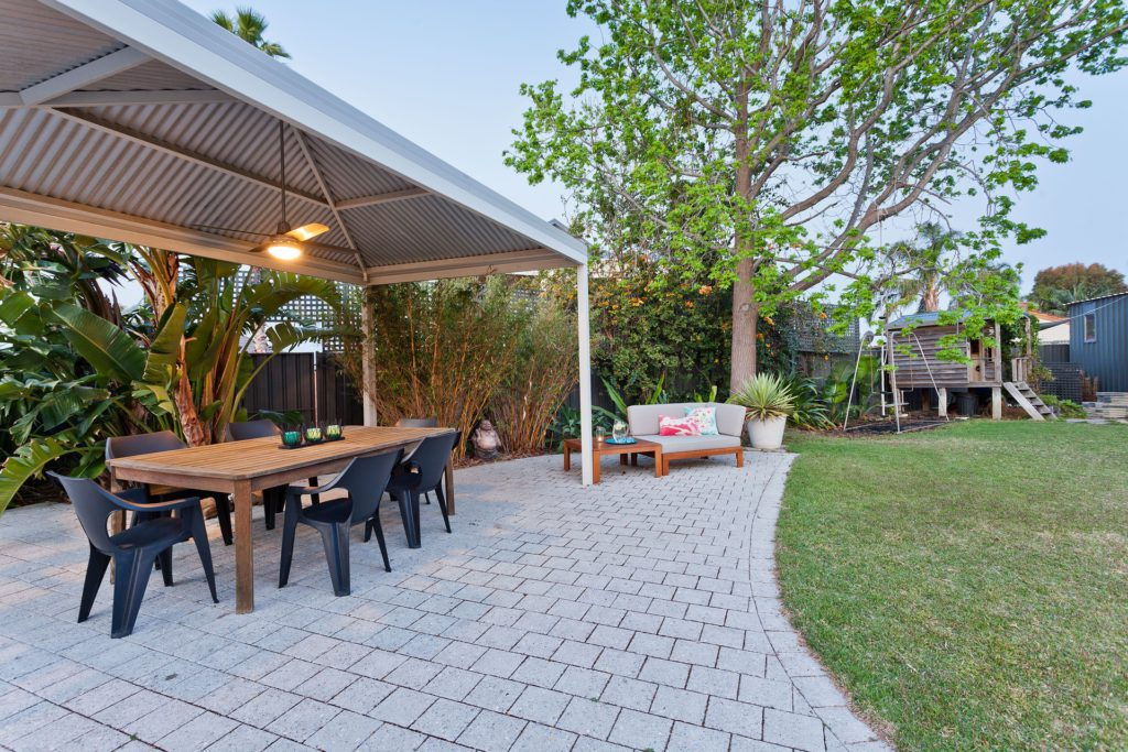 KtichenSpain: View outside barbecue with table and chairs