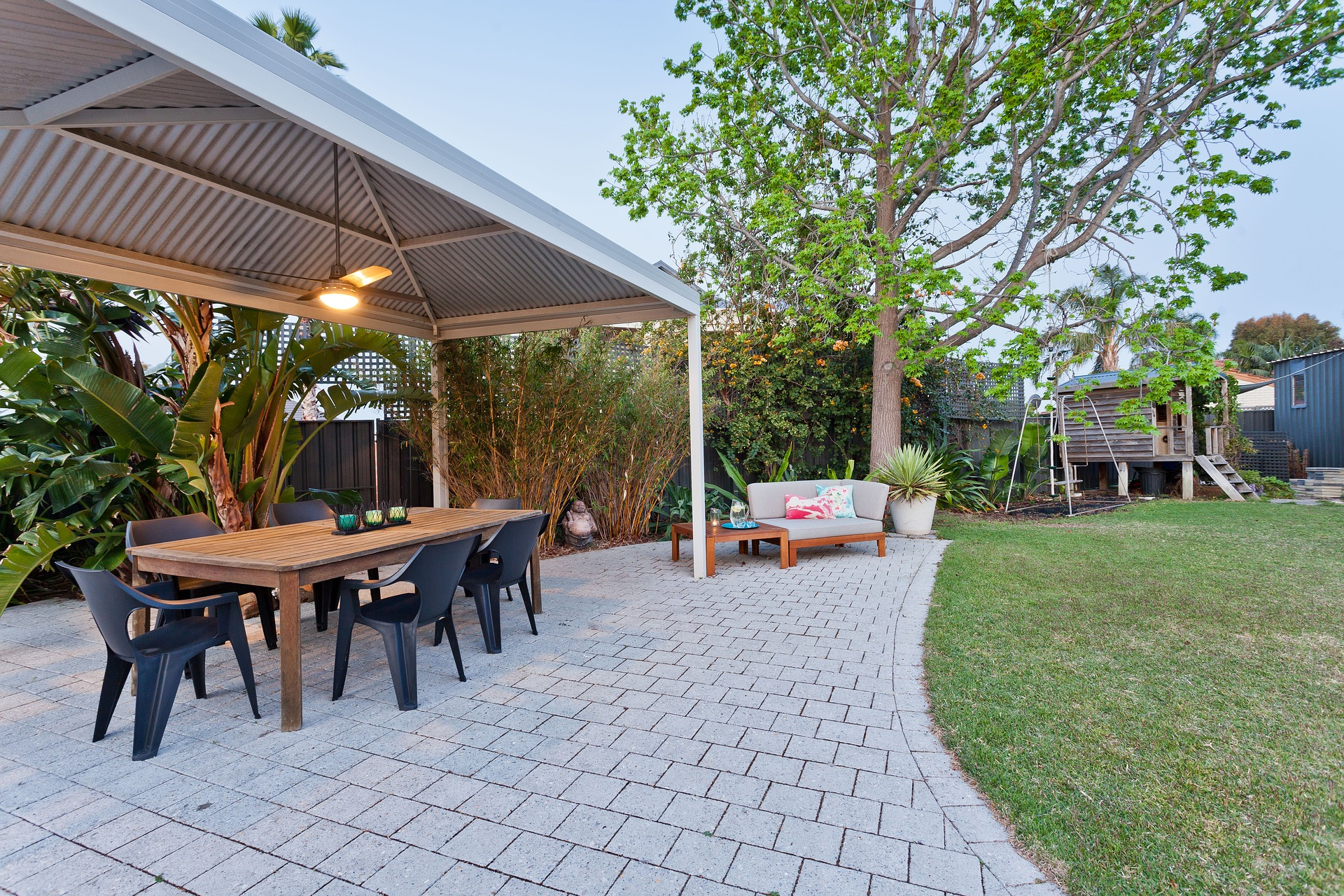 KitchenSpain: View outside from barbecue area with table and chairs